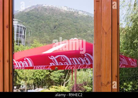 Dajti Mountain view Tirana Albania reflection in window - Stock Photo