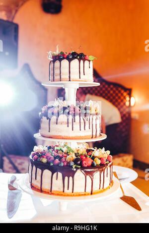 Wedding cake with strawberries, blackberries, blueberries cherries - Stock Photo