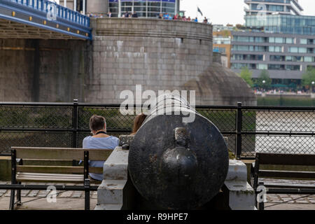 Guns at the Tower Bridge, St. Katherine's Way, London, England, United Kingdom, Europe - Stock Photo