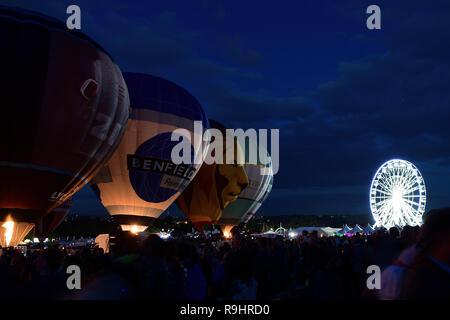 View of hot air balloons during the nightglow at the Bristol international ballon fiesta - Stock Photo