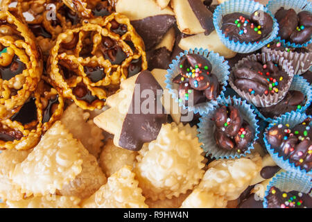 Traditional Christmas home made sweets, cartellate, pastries filled with figs syrup, chocolate and butter biscuits, almond sweets, Bari, Puglia, Italy - Stock Photo