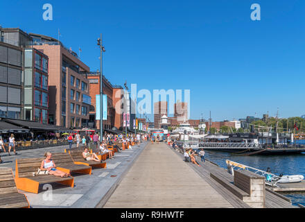 Stranden, in the harbour area, looking towards Rådhusplassen and City Hall, Aker Brygge, Oslo, Norway - Stock Photo