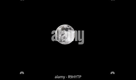 Moon isolated on black background - image of selective focus the real full moon on the dark night sky - Stock Photo