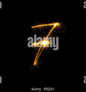 Numbers 0 to 9 created using a sparkler isolated on black background - Stock Photo