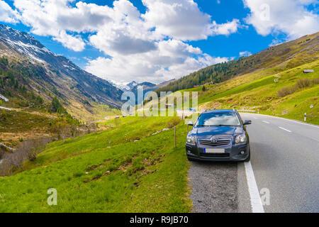 Toyota Avensis T25 in Alps mountains, Fluelapass, Davos,  Graubuenden Switzerland - Stock Photo
