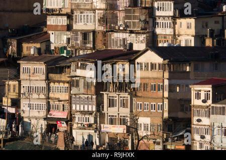 Tiered wooden buildings in Shimla, Himachal Pradesh, India - Stock Photo