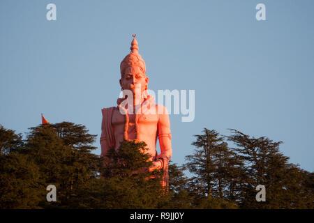Giant Hanuman statue on top of hill at Jakhoo temple in Shimla, Himachal Pradesh, India - Stock Photo