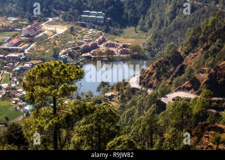 Aerial view of scenic mountain lake with cityscape as viewed from a mountain top at Munsiyari Uttarakhand India. - Stock Photo