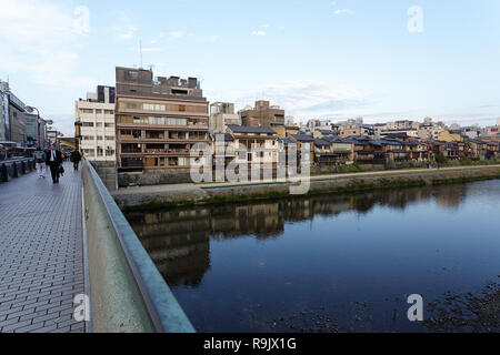 Bridge over the river in Kyoto with pathways along the banks. Japan - Stock Photo