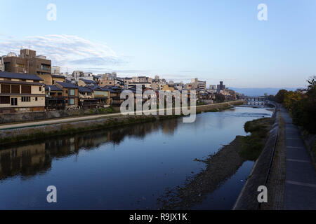View from the bridge over the river in Kyoto with pathways along the banks. Japan - Stock Photo