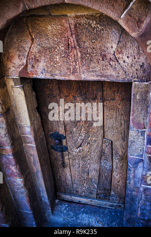 Ancient wooden door in medieval stone structure of St. Adalbert Church from 11th century in Old Town of Krakow in Poland, Europe - Stock Photo