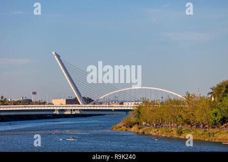 Barqueta and Alamillo bridges on Guadalquivir River in city of Seville, Spain - Stock Photo