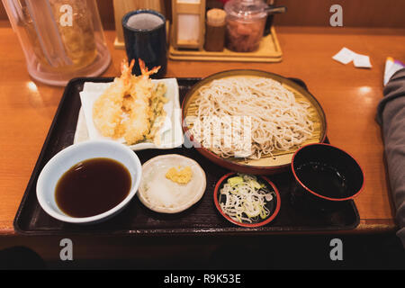Soba and Tempura set in Japanese restaurant on wooden table - Stock Photo
