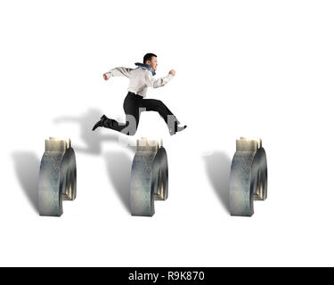 businessman jumping over euro symbols isolated in white background - Stock Photo