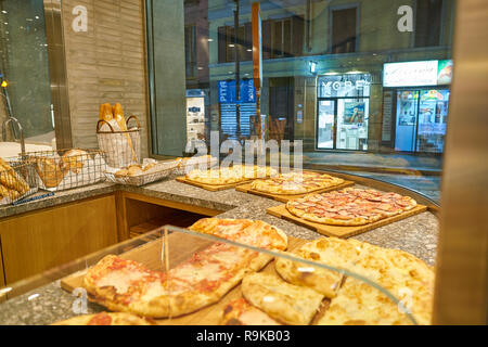 MILAN, ITALY - CIRCA NOVEMBER, 2017: food on display at Farini in Milan. Farini is modern bakery which offers Italian pastry, salads, bowls and pizza - Stock Photo
