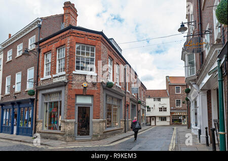York, England - April 2018: Old brick building at corner of Swinegate Street in historic district of City of York, England, UK - Stock Photo