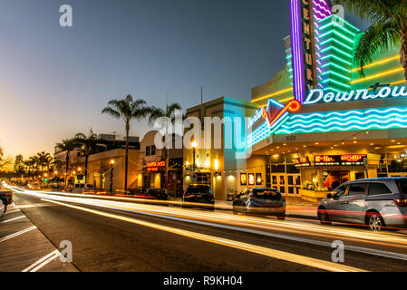 Main Street in downtown Ventura, California, USA decorated with Christmas lights and streaking traffic headlamps at sunset on Christmas Eve, 2018. - Stock Photo