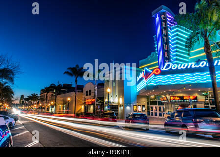 Main Street in downtown Ventura, California, USA decorated with Christmas lights and streaking traffic headlamps under gradient dusk sky on Christmas  - Stock Photo