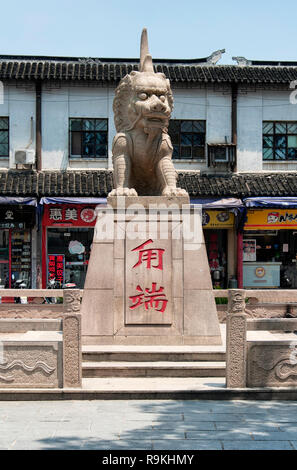 Luzhi Ancient Town, China.  August 1, 2015.  Lu Duan Stone Statue, a mythical animal of Chinese legends at the entrance to Luzhi ancient town in suzho - Stock Photo
