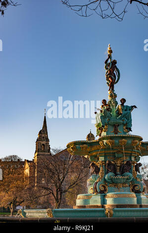 Ross fountain lit by golden sunset light at the foot of the Castle Rock in Edinburgh, Scotland. - Stock Photo