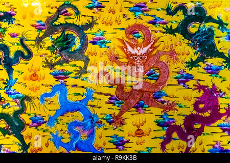 Dragons painted on an old wall in mysterious temple of Trang An in Vietnam - Stock Photo
