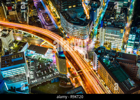 Asia Business concept for real estate & corporate construction - panoramic modern city skyline night view with expressway in Ikebukuro district, Tokyo