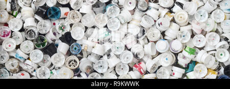 A pattern of many used and soiled nozzles from spray cans with aerosol paint. Background texture of the street art of drawing graffiti on the walls - Stock Photo