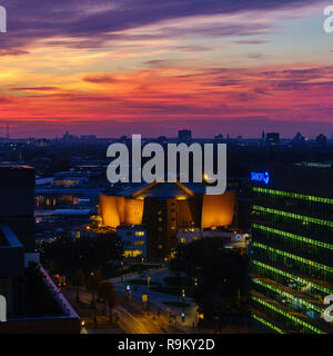 Spectacular sunset over the philharmonic orchestra hall in Berlin, Germany. - Stock Photo