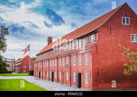 Red barrack in Kastellet, a star shaped fortress in the central part of the city, popular tourist place. Landmark in the old town - Stock Photo