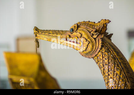 Beautiful traditional Thai style craving patterned of Suphannahong royal barge. Swan head craved pattern in thai royal barge. - Stock Photo