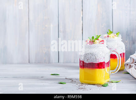 Chia seed pudding in jar with mango. Healthy breakfast. Sweet healthy dessert. - Stock Photo