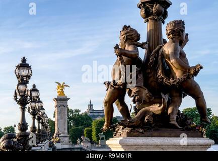 Close-up on a statue of Pont Alexandre III bridge - Paris - Stock Photo