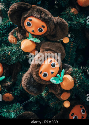 MOSCOW, Russia - December 19, 2018: Christmas tree decorated with toys Cheburashki. Christmas tree soviet toy Cheburashka in the shopping center GUM on red square in Moscow.