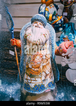 MOSCOW, Russia - December 19, 2018: Figurine of Father Frost Santa Claus Ded Moroz on the shop window Christmas Market in Red Square, Moscow. Sale of toys, famous and popular fairy-tale characters, figurines