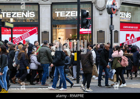 December 26, 2018 - United Kingdom - Tens of thousands of shoppers are seen taking advantage of post-Christmas bargains on Oxford Street during the Boxing Day sales..According to a recent study, 150,000 jobs were lost during 2018 as troubled UK high-street retailers are hit by high business property taxation, flagging growth and rising online sales. (Credit Image: © Dinendra Haria/SOPA Images via ZUMA Wire) - Stock Photo