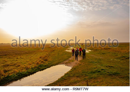RSPB Marshside, Southport Beach, People walking off their Christmas excesses on a slightly misty Boxing Day afternoon at RSPB Marshside Nature Reserve as the light starts to fade in the Merseyside seaside town , Lancashire, England UK Credit: Christopher Canty Photography/Alamy Live News - Stock Photo