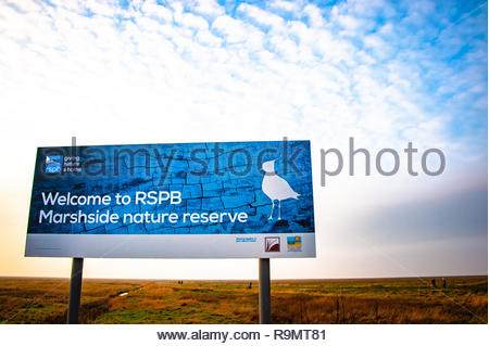 RSPB Marshside Nature Reserve 'Welcome to RSPB Marshside' sign in Southport, the light starts to fade at the end of a winters day on Merseyside, Lancashire, England UK Credit: Christopher Canty Photography/Alamy Live News - Stock Photo