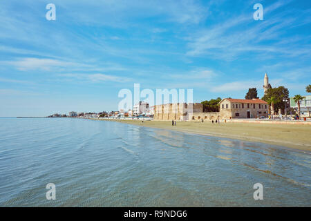 The busy Finikoudes beach next to the old castle in the city centre, Larnaca, Cyprus. - Stock Photo