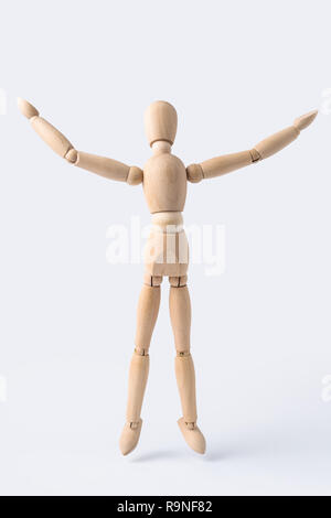 Business and design concept - wooden mannequin with open arm gesture isolated on white background - Stock Photo