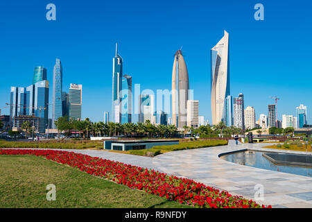 Daytime skyline of downtown Kuwait City from Al Shaheed Park in Kuwait, Middle East - Stock Photo