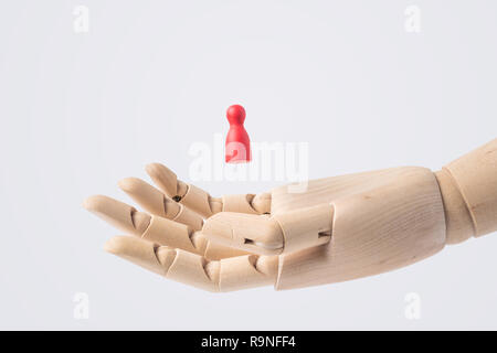 Business and design concept - wooden hand with red chess isolated on white background - Stock Photo