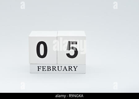 White wooden calendar with 5th February date is Chinese New Year. Minimal style greeting card to celebrate Chinese New Year - Stock Photo