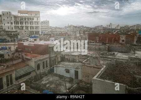 Panoramic view over the rooftops of Havana City in Cuba. The run-down buildings mostly in colonial style provide a special flair for visitors and tour - Stock Photo