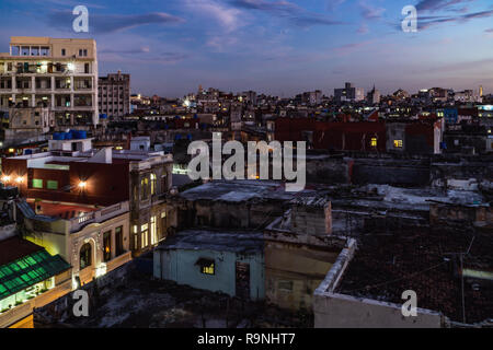 Panoramic night view over the roof tops of Havanna in Cuba right at the sunset. - Stock Photo