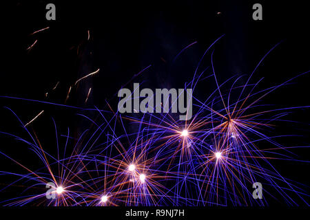 Fireworks in the sky. Blue and yellow lights in the shape of a star. Lights for festivities - Stock Photo