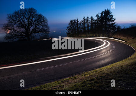 light trails from a car in a curve - Stock Photo