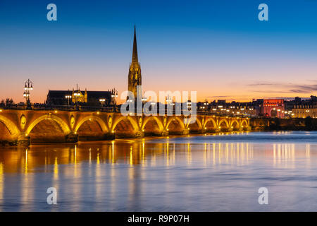 Pont de Pierre at dusk. Stone Bridge & Garonne River. Bordeaux, Gironde. Aquitaine region. France Europe - Stock Photo