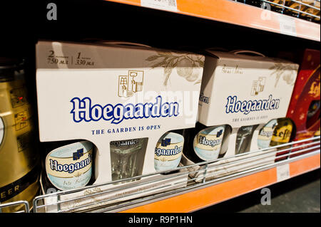 Kyiv, Ukraine - December 19, 2018: Hoegaarden packages on shelves in a supermarket.  Hoegaarden is a brewery in Belgium and the producer of a well-kno - Stock Photo