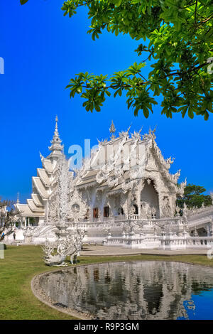 Wat Rong Khun, commonly known as the White Temple, in Chiang Rai, Thailand - Stock Photo