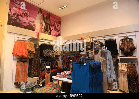 COLOMBO, SRI LANKA - SEPTEMBER 05, 2016:  Wide View of Ladies wear Clothes, Dresses, Skirts, Frocks, Trousers, Jackets, with Shelves, Racks and Hanger - Stock Photo